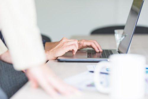 Laptop hands meeting