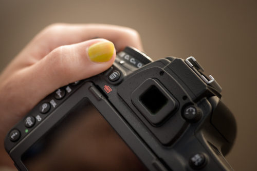 Camera lens woman